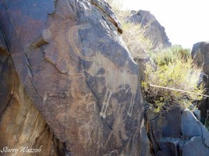 Long Horned Goat and Rider, with later petroglyph beneath